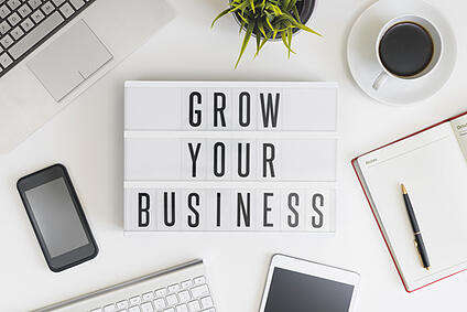 Grow your business words on office table