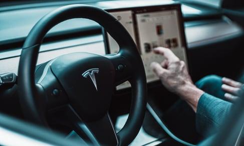 Tesla logo on vehicle steering wheel