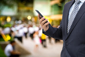Business man holding cell phone